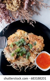 Oysters fried in egg batter, thai food isolated in white background
