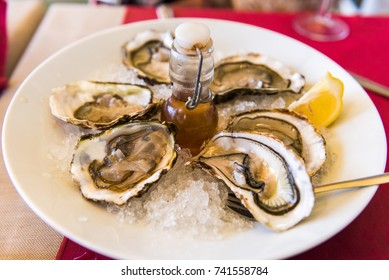 Oysters with lemon on a plate, Sete, France. Close-up