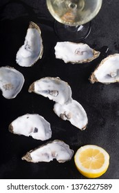 Oysters on black chalkboard, toned image. Shellfish contains a mass of beneficial micronutrients and vitamins that beneficially affect the entire body