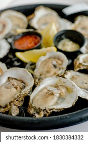 Oysters. Oysters on the half shell. Fresh oysters served with garlic, shallots, cocktail sauce, mignonette sauce and fresh lemons and limes. Classic American steakhouse or French bistro appetizer.