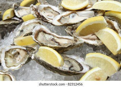 Oysters on ice with lemon.