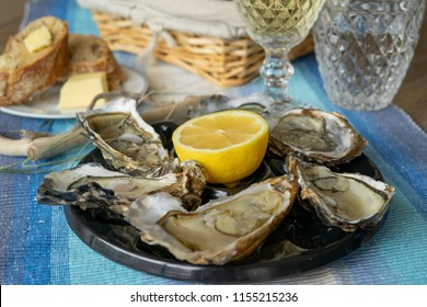 oysters plate and wine