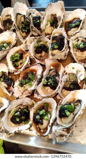 Oysters steamed with black bean sauce in dim sum restaurant