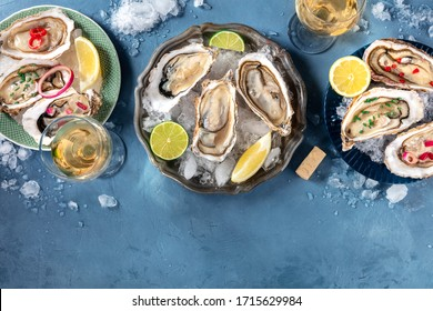 Oysters with various toppings, shot from above with wine, with lemon and lime, pepper, onion, with a place for text