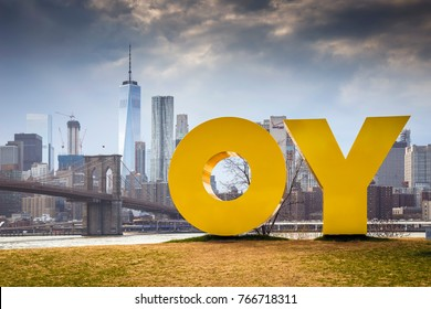 OY/YO yellow solid sculpture by Deborah Kass at Brooklyn Bridge Park - Brooklyn, New York, April 2016