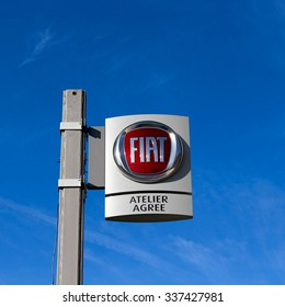 """OZOIR LA FERRIERE, FRANCE - NOVEMBER 8, 2015: Logo of the Fiat brand with the inscription """"authorized workshop"""" in Ozoir la Ferriere, France. Fiat is an Italian automobile manufacturer."""