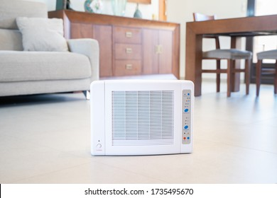 Ozone machine generator inside the living room floor. Home cleaning and disinfection during covid 19 epidemic. Domestic safety equipment. - Shutterstock ID 1735495670