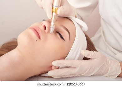 Ozone treatment with cosmetology apparat. Physiotheraphy. Lifting effect . Ozone face skin rejuvenation, regeneration of face and neck skin. Spa salon. Cosmetology room