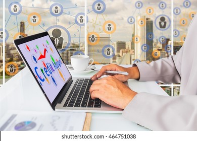 P2P lending concept.  Business man using laptop computer with P2P lending icons and credit approved message on screen, cup of coffee against social media connection on city background.