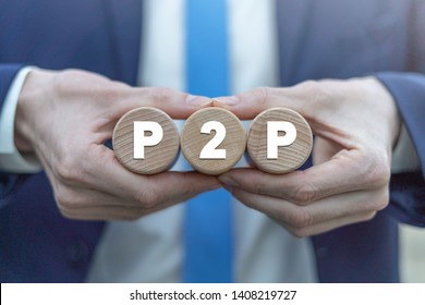 P2P peer to peer technology web network business concept on a wooden cylinders in a businessman hands.