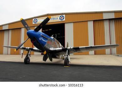 P-51B Mustang in front of airport hanger