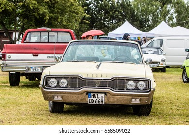 Paaren im Glien, Berlin, Germany, June 03, 2017, Oldtimer Show: Dodge in rain, glossy and shiny old classic retro muscle car