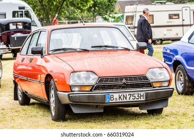 Paaren im Glien, Berlin, Germany, June 03, 2017, Oldtimer Show: Citroen in rain, glossy and shiny old classic retro car
