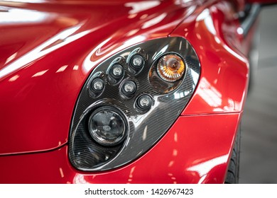 PAAREN IM GLIEN, GERMANY - JUNE 08, 2019: Headlamp of the sports car Alfa Romeo 4C Spider (Type 960). Close-up. Die Oldtimer Show 2019.