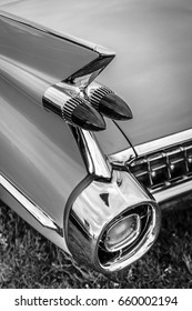 """PAAREN IM GLIEN, GERMANY - JUNE 03, 2017: Rear stoplights of a full-size luxury car Cadillac Coupe DeVille, 1959. Black and white. Exhibition """"Die Oldtimer Show""""."""