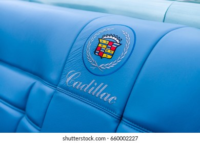 "PAAREN IM GLIEN, GERMANY - JUNE 03, 2017: Emblem in the form of embroidery on the seat-cover of a full-size personal luxury car Cadillac Eldorado. Exhibition ""Die Oldtimer Show""."