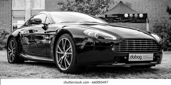 "PAAREN IM GLIEN, GERMANY - JUNE 03, 2017: Sports car Aston Martin Vantage, 2010. Black and white. Exhibition ""Die Oldtimer Show""."