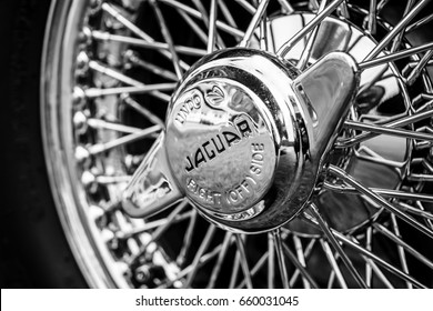 "PAAREN IM GLIEN, GERMANY - JUNE 03, 2017: Hubcap of sports car Jaguar E-Type, closeup. Black and white. Exhibition ""Die Oldtimer Show""."