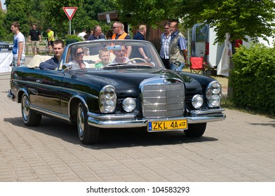 "PAAREN IM GLIEN, GERMANY - MAY 26: Car Mercedes-Benz 220 SE Convertible, ""The oldtimer show"" in MAFZ, May 26, 2012 in Paaren im Glien, Germany"