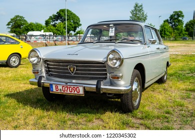 PAAREN IM GLIEN, GERMANY - MAY 19, 2018: Large family car Peugeot 404 SL, 1968. Die Oldtimer Show 2018.