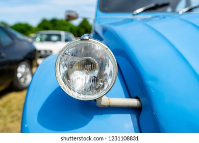 PAAREN IM GLIEN, GERMANY - MAY 19, 2018: Headlamp of the tconomy car Citroen 2CV. Die Oldtimer Show 2018.