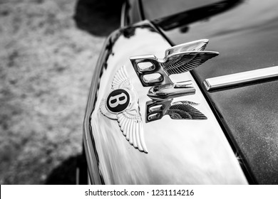 PAAREN IM GLIEN, GERMANY - MAY 19, 2018: Hood ornament of a full-size luxury car Bentley Mulsanne, 1986. Black and white. Die Oldtimer Show 2018.