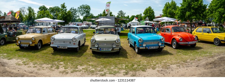 PAAREN IM GLIEN, GERMANY - MAY 19, 2018: Panoramic view of German vintage cars (Trabant, VW Beetle, VW Golf). Die Oldtimer Show 2018.