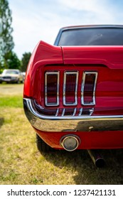 "PAAREN IM GLIEN, GERMANY - MAY 19, 2018: Rear stoplight of a muscle car Ford Mustang. Exhibition ""Die Oldtimer Show 2018""."