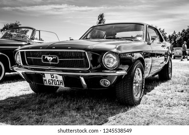 PAAREN IM GLIEN, GERMANY - MAY 19, 2018: Iconic American car Ford Mustang (first generation). Black and white. Die Oldtimer Show 2018.
