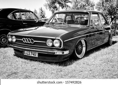 """PAAREN IM GLIEN, GERMANY - MAY 19: Compact executive car Audi 80 B1, black and white """"The oldtimer show"""" in MAFZ, May 19, 2013 in Paaren im Glien, Germany"""