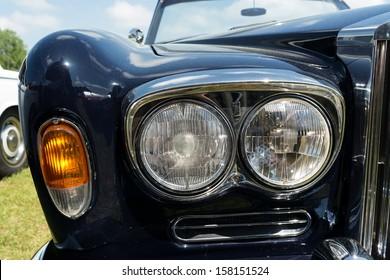"PAAREN IM GLIEN, GERMANY - MAY 19: Headlamp luxury car Rolls-Royce Silver Shadow, ""The oldtimer show"" in MAFZ, May 19, 2013 in Paaren im Glien, Germany"