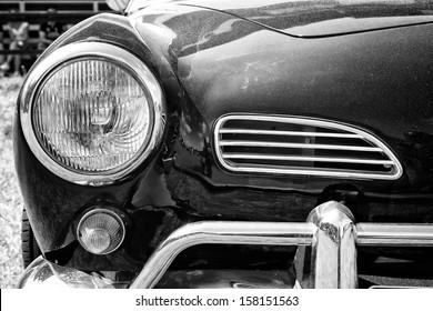 "PAAREN IM GLIEN, GERMANY - MAY 19: Headlamp car Volkswagen Karmann Ghia, black and white, ""The oldtimer show"" in MAFZ, May 19, 2013 in Paaren im Glien, Germany"