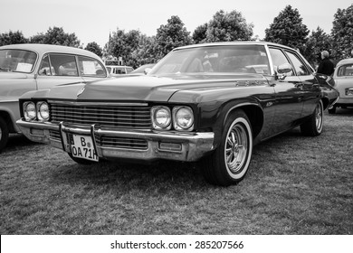 PAAREN IM GLIEN, GERMANY - MAY 23, 2015: Full-size luxury car Buick LeSabre Sedan (Fourth generation), 1971. Black and white. The oldtimer show in MAFZ.