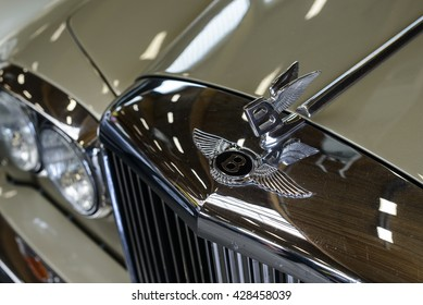"PAAREN IM GLIEN, GERMANY - MAY 15: Close up of a Bentley logo on a retro car Bentley R Type, ""The oldtimer show"" in MAFZ, May 15, 2016 in Paaren im Glien, Germany"