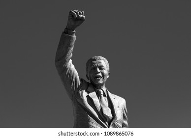 PAARL, SOUTH AFRICA - MAY 3, 2018: Statue of Nelson Mandela in black and white with raised fist near Drakenstein Correctional Centre.