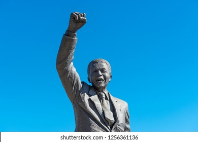 PAARL, SOUTH AFRICA - MAY 3, 2018: Statue of Nelson Mandela in color with a raised fist near Drakenstein Correctional Centre.