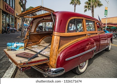 Pacific  Beach / United States – August 16, 2015: A 1949 Oldsmobile Woody Wagon with its back doors open at Charger Steve's Wild Rides and Classic Car Showdown.