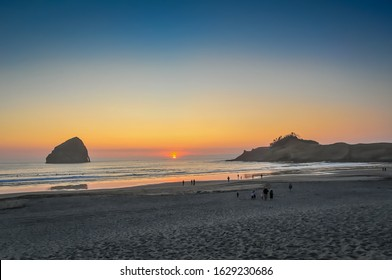 Pacific City Beach, Oregon, USA. Popular out of the way beach on Oregon's central coast. Featuring a large sea stack offshore, beautiful sand, a surfer destination, and beachfront brewery/restaurant.