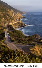 The Pacific Coast Highway winds along the Big Surf coastline in California.