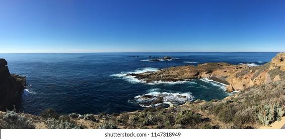 Pacific coast ocean rock cliff at Point Lobos, Carmel-by-the-Sea, CA