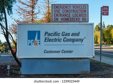 Pacific Gas and Electric Company logo and company name near its customer service center. PG&E provides natural gas and electricity to Northern California - Cupertino, California, USA - March 14, 2019