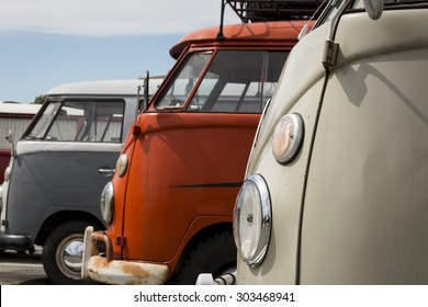 PACIFIC GROVE, CALIFORNIA, UNITED STATES - August 5, 2015: Three classic Volkswagen Buses parked in a row at a car show in downtown Pacific Grove.