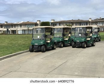 PACIFIC GROVE, USA - MAY 12, 2017: green golf cart parked near grass by the ocean in Pebble Beach
