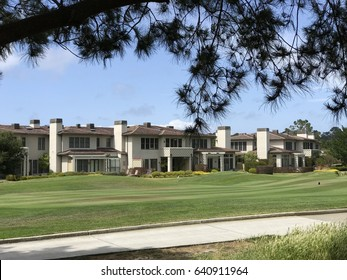 PACIFIC GROVE, USA - MAY 12, 2017: green golf course with condominium residencies in Pebble Beach