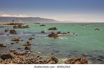 The Pacific Ocean coast of Northern California, beautiful blue waves, sunny sky.