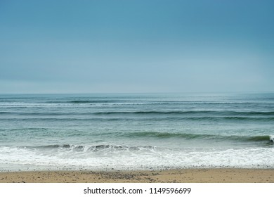 Pacific Ocean, coastline of the ocean with a sandy beach and waves