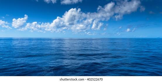 Pacific ocean horizon cloud reflections Whitsunday passage