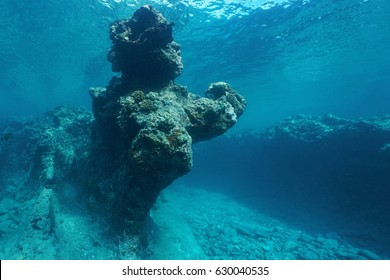 Pacific ocean natural rock formation underwater carved by the waves in the outer reef of Huahine island, French Polynesia