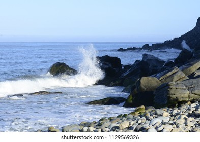Pacific Ocean wave splashes on rock coast Baja, Mexico
