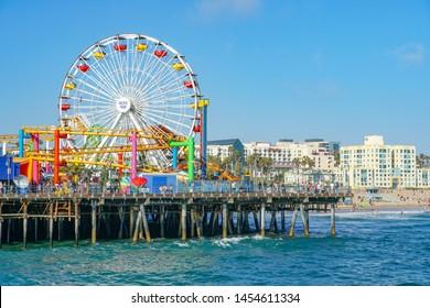 Pacific Park, a family amusement park on Santa Monica Pier. Los Angeles, California, USA. Oceanfront amusement park. Famous tourist attraction. 07/13/2019